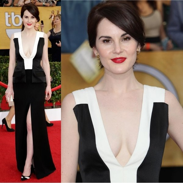 Michelle Dockery displayed both her cleavage and legs with an extremely low-cut neckline and a thigh-high slit