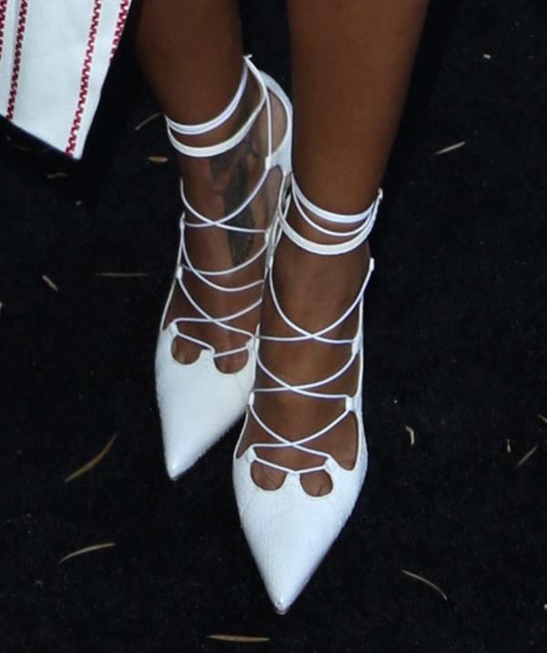 Rihanna wearing Manolo Blahnik lace-up shoes