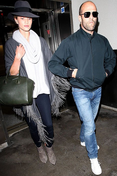 Rosie Huntington-Whiteley and Jason Statham arriving at LAX in Los Angeles, California, on January 9, 2014