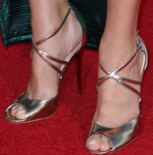 """Sandra Bullock completed the outfit with Jimmy Choo """"Valetta"""" sandals, which are strappy and in mirrored leather"""