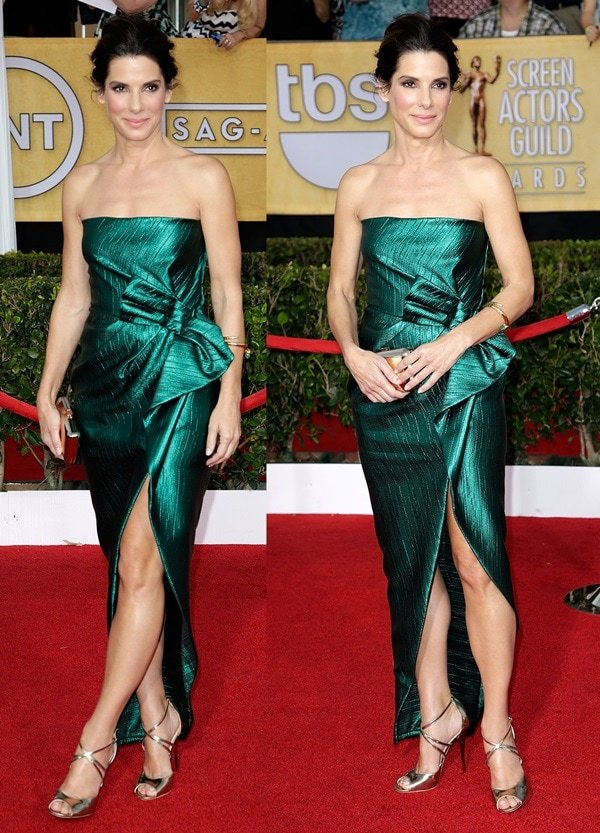 Sandra Bullock styled a strapless emerald green gown by Lanvin with a metallic Roger Vivier Boite de Nuit clutch and a simple gold bangle by Fred Leighton
