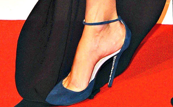 Her blue suede pumps looked out of place and didn't seem to complement her beautiful gown
