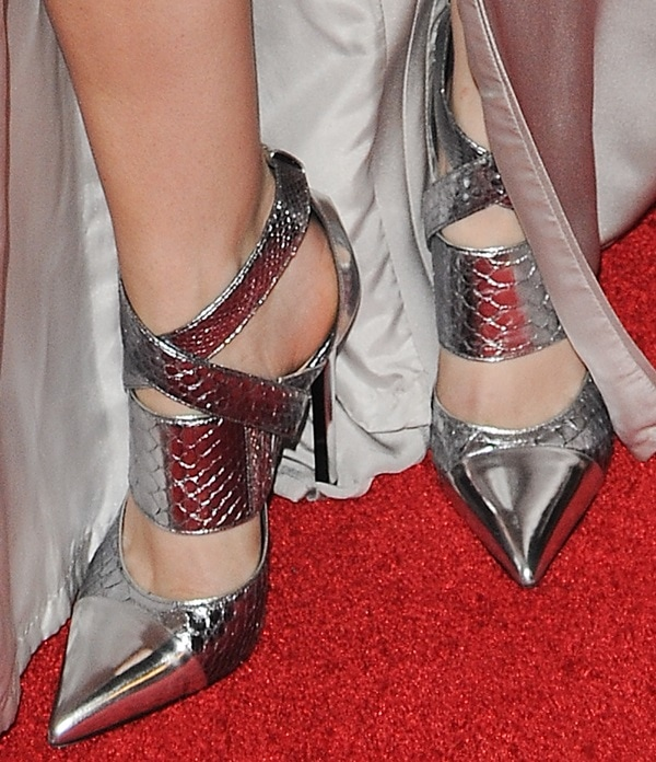 A closer look at Anna's matching silver ankle-wrap pumps