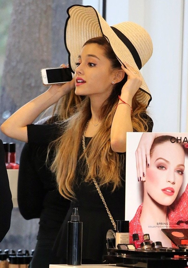 Ariana Grande trying out cosmetics and a cute floppy hat