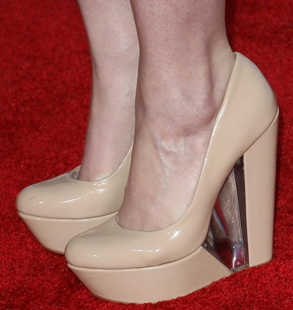Ashley Rickards wearing patent wedges from Aldo