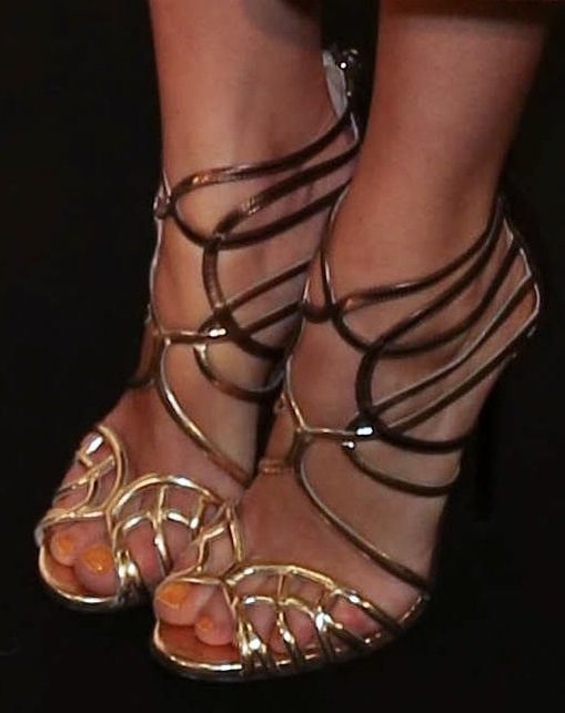 Bianca Suarez wearing gold strappy sandals