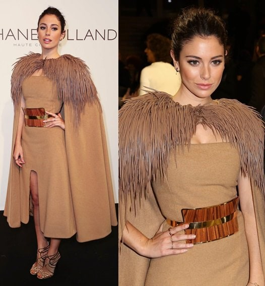 Bianca Suarez rocked a statement cape with her hi-low hemline dress and punctuated the look with gold strappy sandals