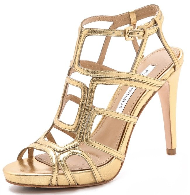 Luxe metallic straps make a cubist pattern on these leather DVF sandals