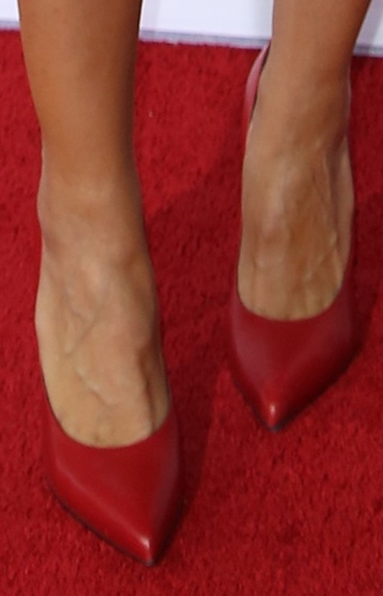 Heidi Klum wearing red pointy pumps