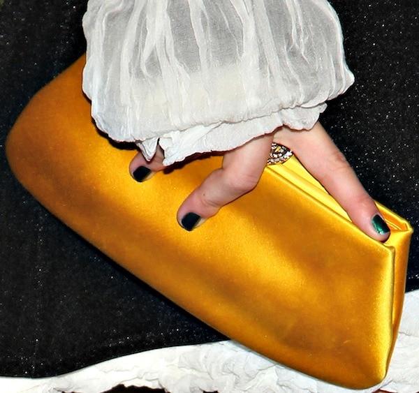 Julianne Hough's gold clutch