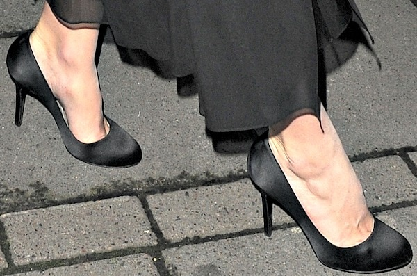 Keira Knightley wearingblack satin pumps