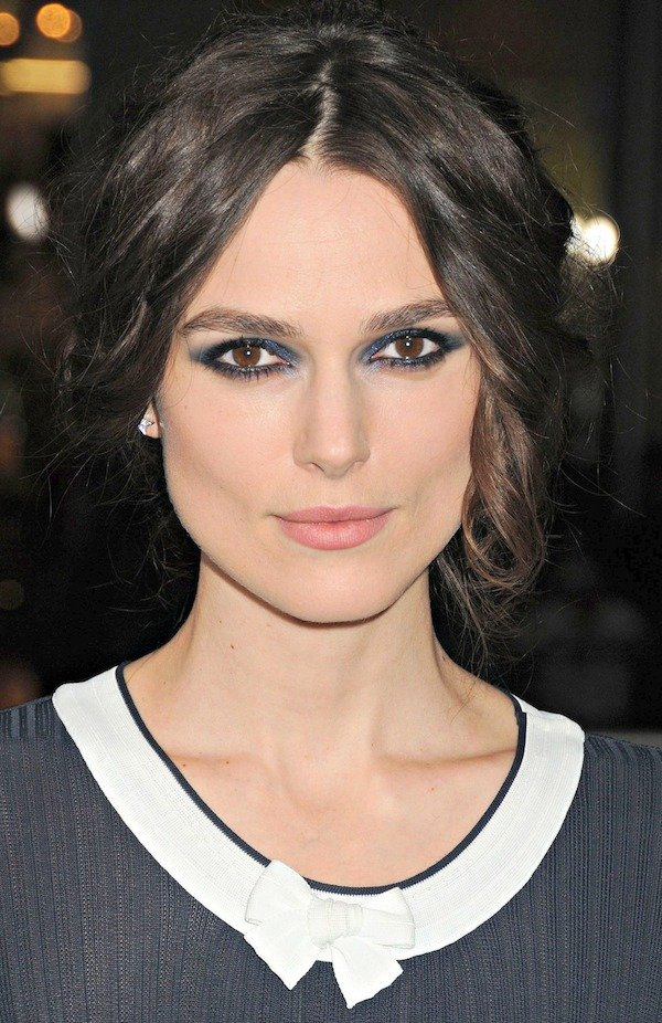 Keira Knightley with her hair pulled back into a messy updo