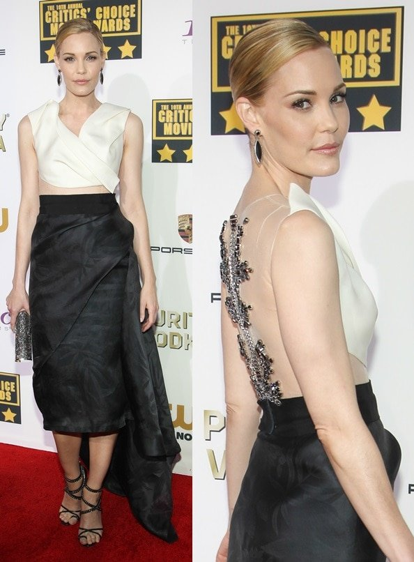 Leslie Bibb in a black-and-white dress featuring a sexy high-low hemline and a sheer-paneled bodice that showcases some fabulous metalwork on the back