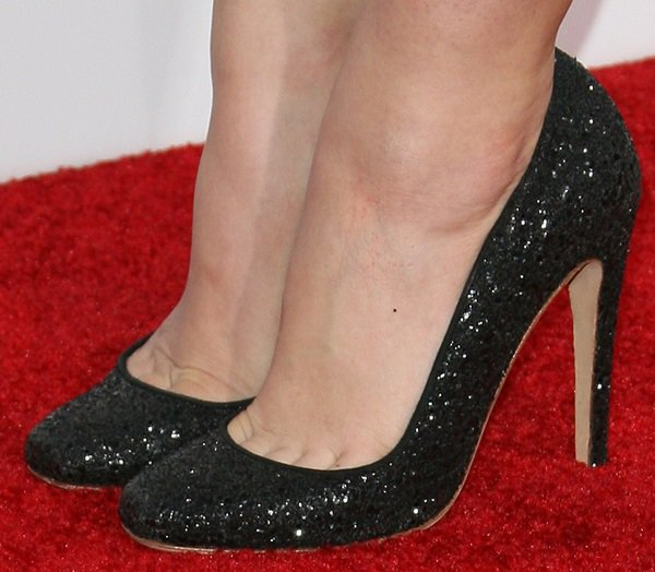 Lucy Hale showing toe cleavage in glittered black pumps from Jerome Rousseau