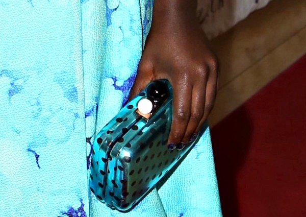 Lupita Nyong'o totinga polka-dotted clutch from Sophia Webster