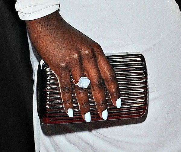 Lupita Nyong'o totinga metallic clutch from Monica Rich Kosann