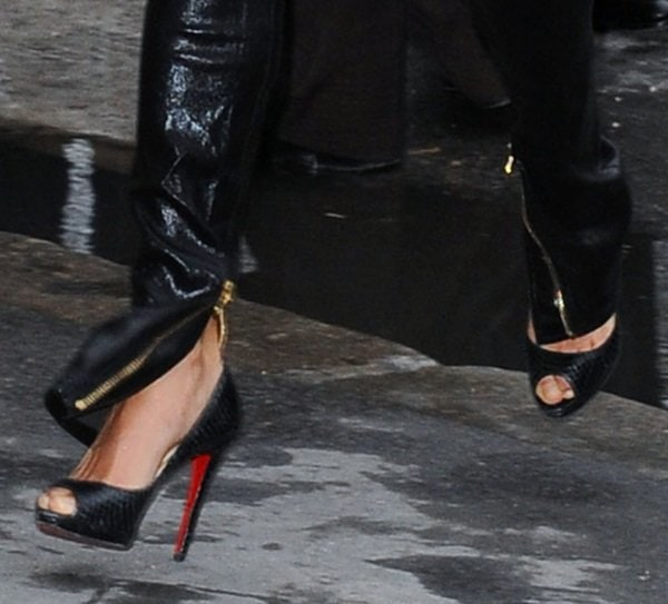 Michelle Rodriguez wearing classic snake-print peep-toe pumps from Christian Louboutin