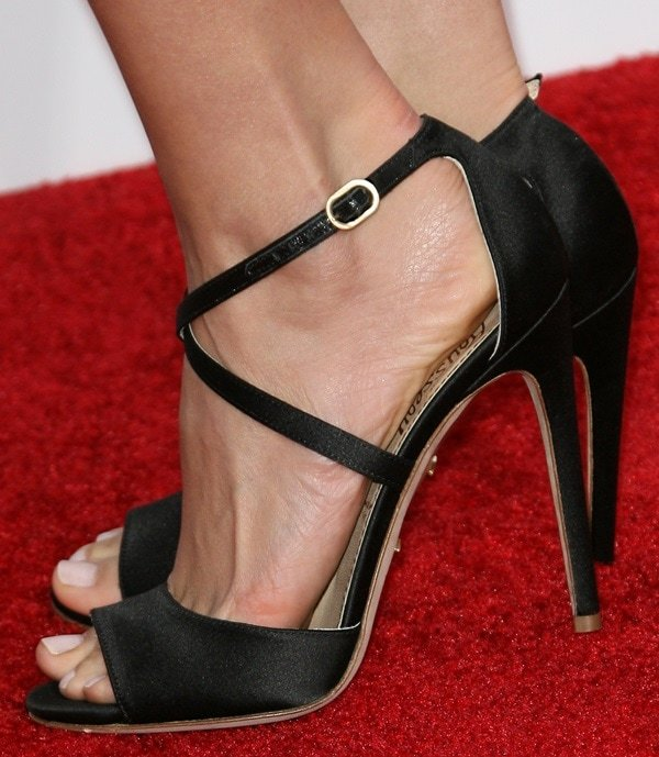 Olga Fonda's sexy feet in black satin cross-strap sandals from Jerome Rousseau