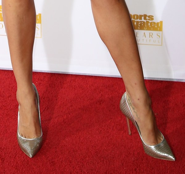 Petra wearing metallic pointy pumps