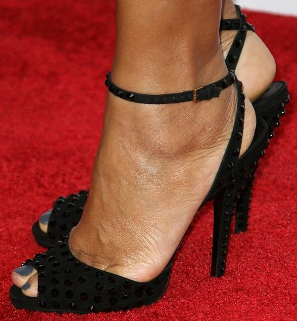 Queen Latifah showing off her feet in studded ankle-wrap sandals