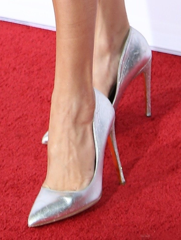 Rebecca Romijn wearing silver metallic pointy pumps from Christian Louboutin