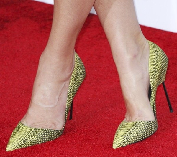Sandra Bullock showing off her feet in exotic snake-print pumps from Kurt Geiger