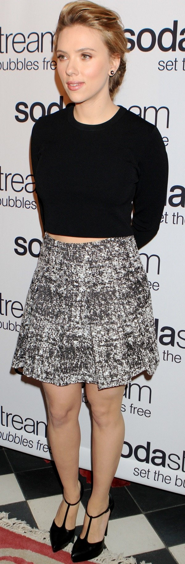 Scarlett Johansson in a cropped sweater with a gray pleated skirt