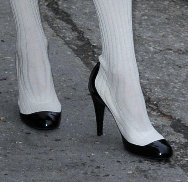 Tilda Swinton wearing color-blocked pump-boot hybrids