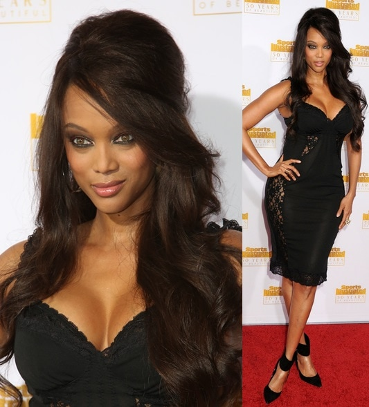Tyra Banks showing off her assets in a lace-detailed LBD at the 50th anniversary celebration of Sports Illustrated at Dolby Theatre in Beverly Hills on January 14, 2014