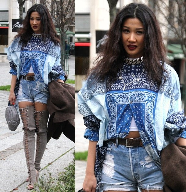 Yoon rocking a printed shirt with high-waist denim shorts and open-toe, thigh-high lace-up boots for the Louis Vuitton Fall 2014 Menswear show during Paris Fashion Week in France on January 16, 2014