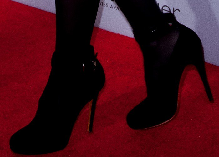 Cameron Diaz wears a pair of Celine ankle-wrap pumps over a pair of black tights
