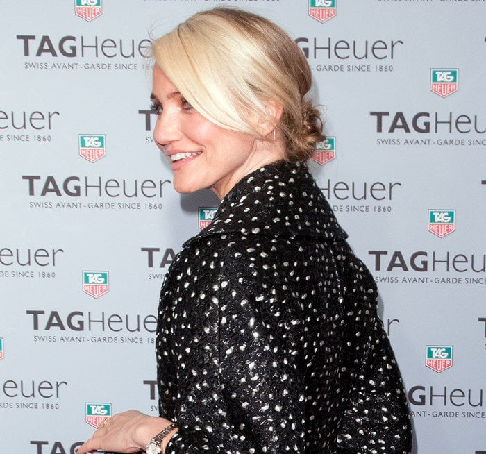 Cameron Diaz wears her hair in a messy bun at the opening of Tag Heuer's first flagship store in New York City