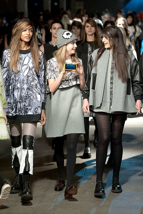 Cara Delevingne holding up her phone at the finale of theGiles Fall 2014 fashion show