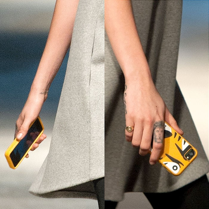 The tiger-print-encased phone in Cara Delevingne's hand, which the model carried on the Giles Fall 2014 runway