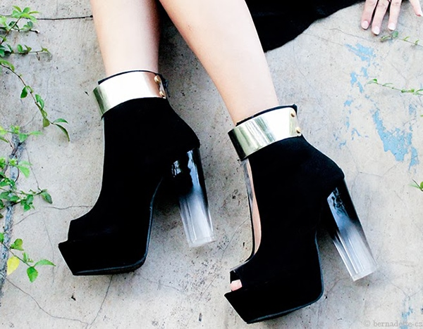 Black suede booties with clear PVC panels down the front, peep toes, gold-tone metal plates at the cuffs, and chunky Lucite ombre heels