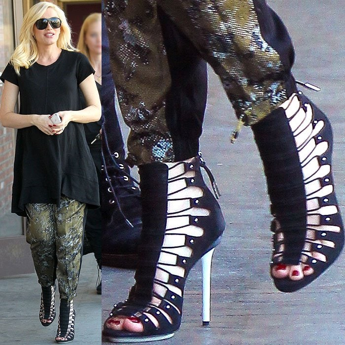 Gwen Stefani wearing black strappy sandal booties