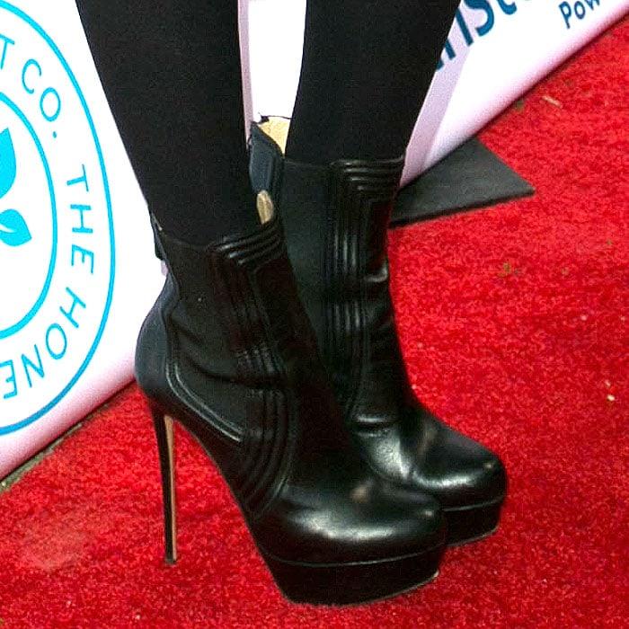 Jessica Alba sporting black platform booties