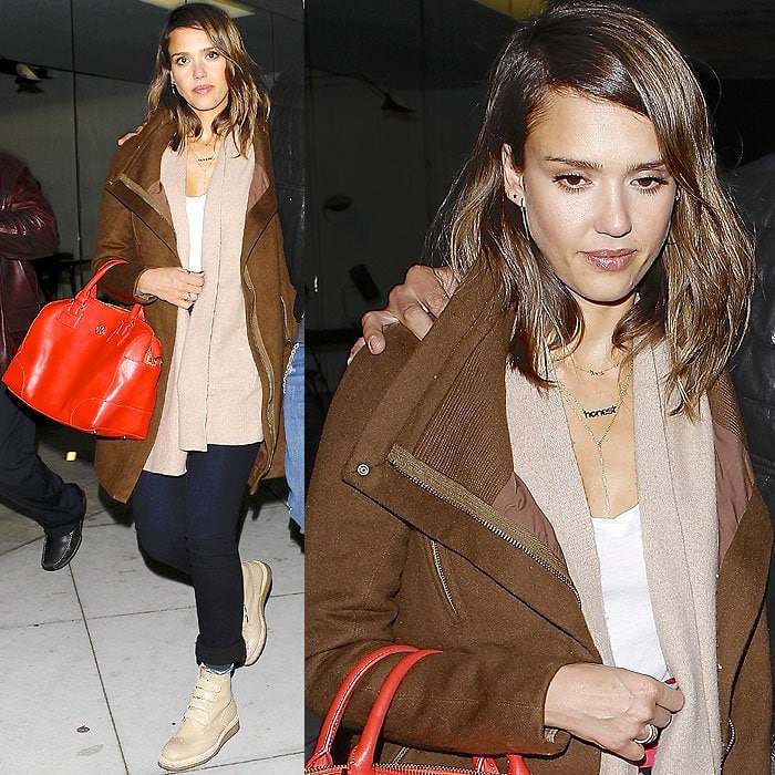 Jessica Alba layered warmly in a sand-colored cardigan and a dark tan jacket