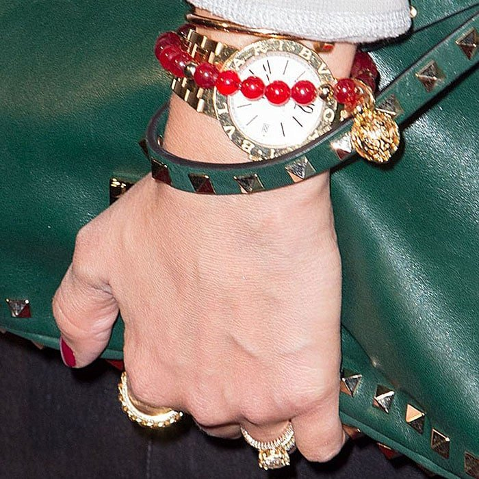 Jessica Alba wearing red, green, and gold bracelets