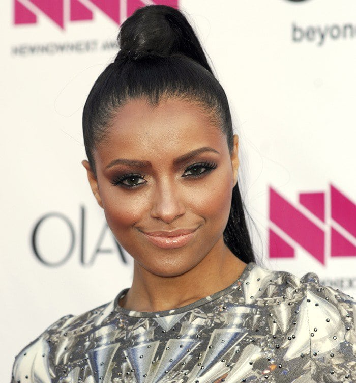 Kat Graham in a figure-hugging dress from The Blonds
