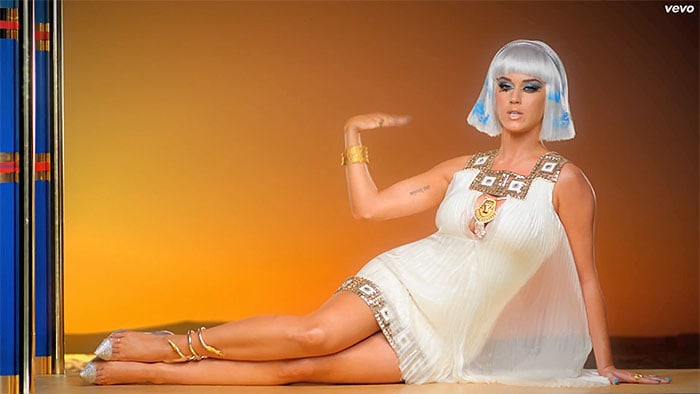 Katy amped it up with a blue stenciled white wig blue nails a gold