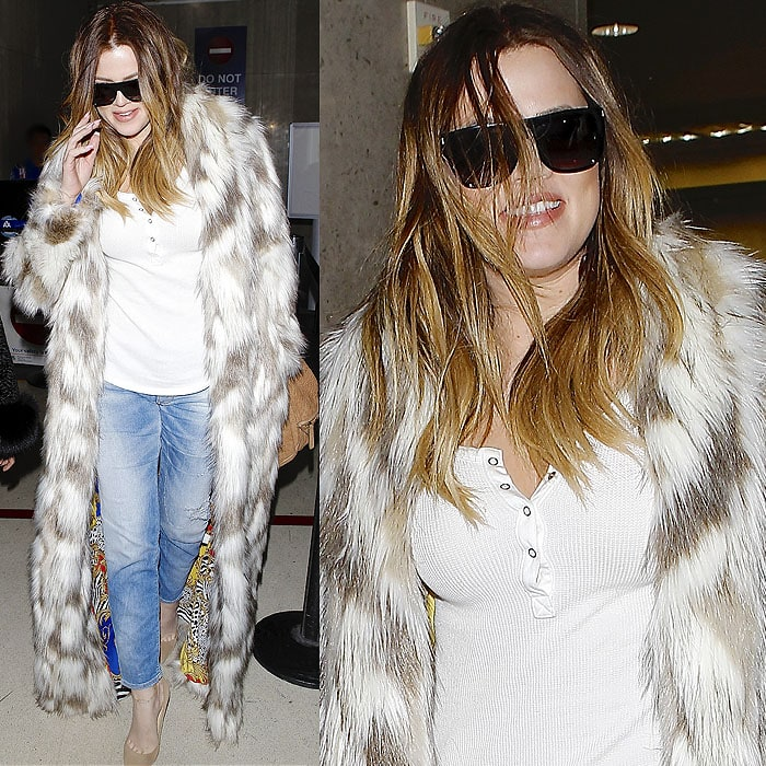 """Khloe Kardashian wears her hair down in a faux-fur coat with """"FXCK Yo Fur"""" spray painted on the back"""