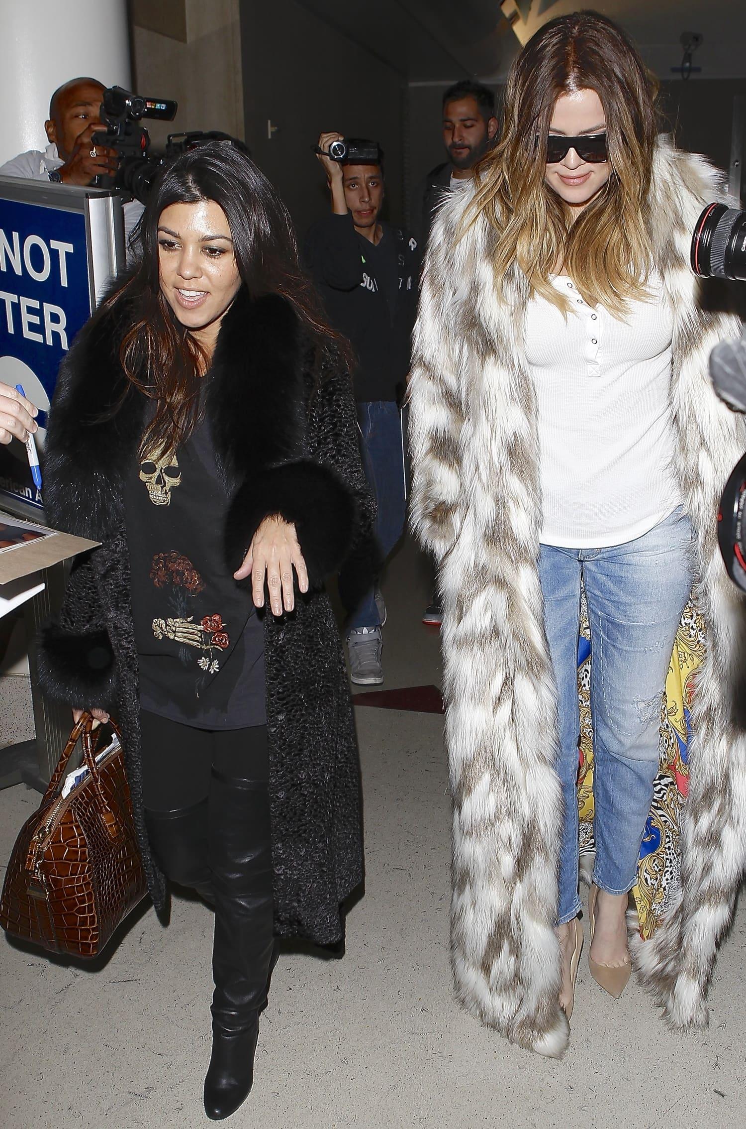 Khloe and Kourtney Kardashian arrive at Los Angeles International (LAX) airport