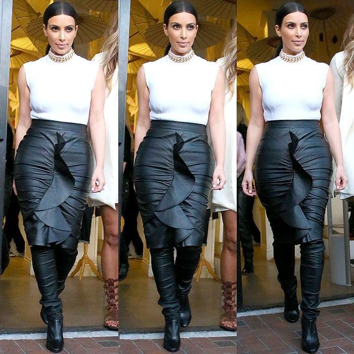 Kim Kardashian wears a super tight, hug-every-single-curve leather skirt by Givenchy