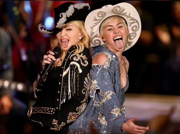 Madonna joining Miley for two songs (and tongue wagging) at her MTV Unplugged show in Los Angeles on January 29, 2014