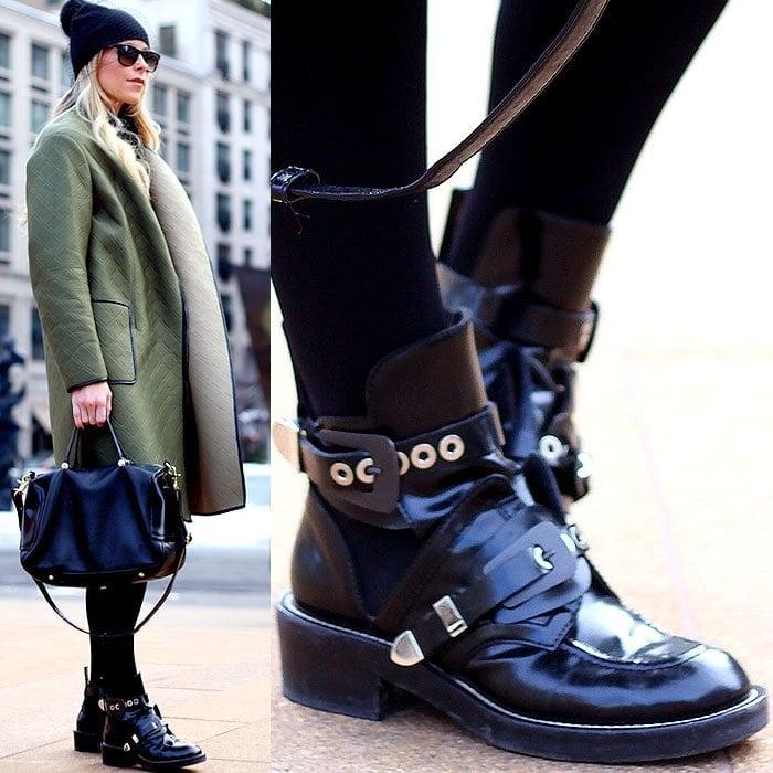 Model wears Balenciaga cutout booties worn with socks