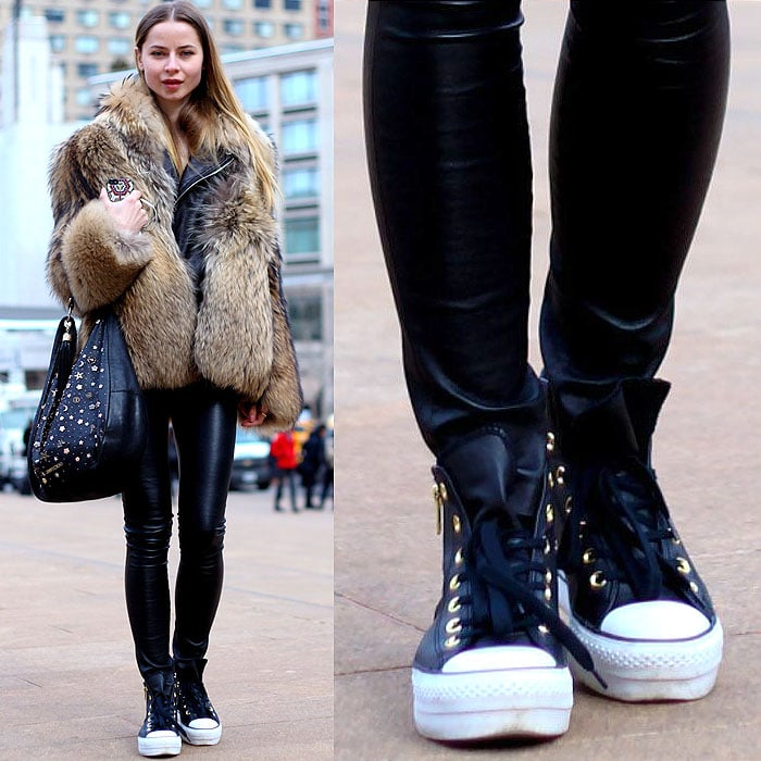Model wears Chuck Taylors with a fur coat