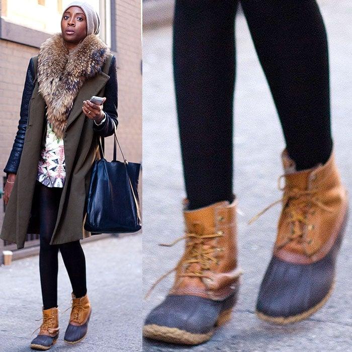 Model wears sensible duck boots