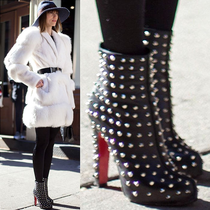 Model wears spiked Louboutins with a white coat