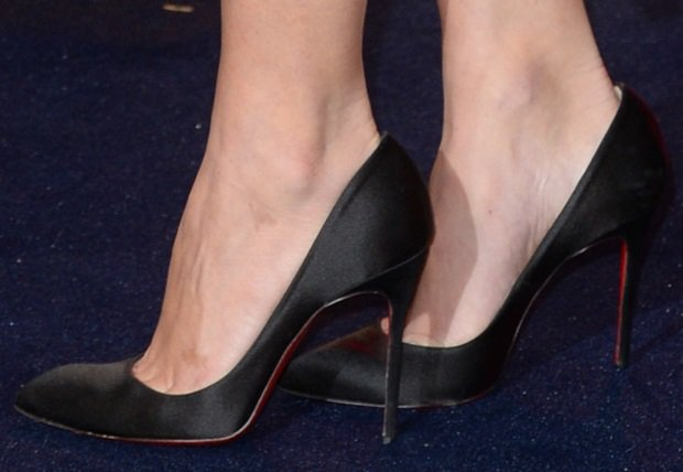 Olivia Munn shows off her feet in black Christian Louboutin shoes